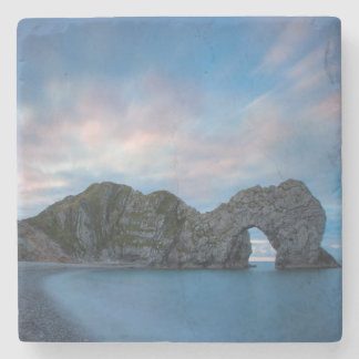 Colorful sky at dawn over Durdle Door Stone Coaster