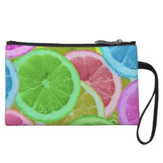 colorful slices of lemon and orange wristlet purses