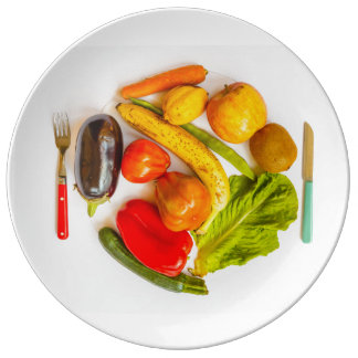 coloured vegetables and fruits on porcelaine plate