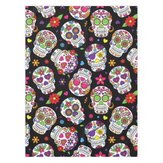Colourful Sugar Skulls On Black Tablecloth