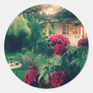 Cottage garden with rhodies round sticker