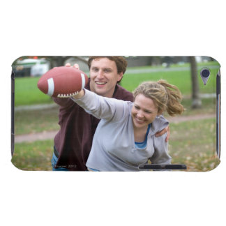 Couple playing football in park iPod touch covers