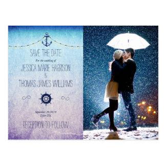 Couple with umbrella kissing at snow/nautic theme postcard