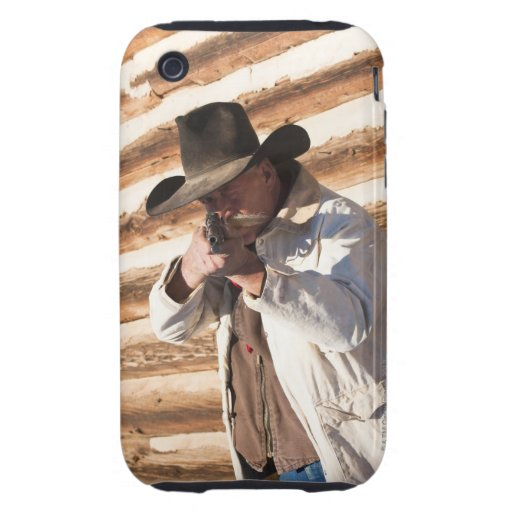 Cowboy aiming his gun, standing by an old log tough iPhone 3 cases