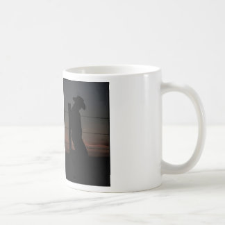 Cowboy at sunset coffee mug
