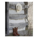 Cowboy boots and hat outside of log cabin print