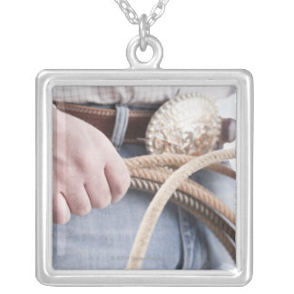 Cowboy holding a rope silver plated necklace