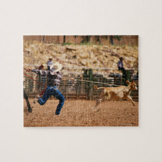 Cowboy roping calf in rodeo jigsaw puzzle