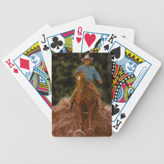 Cowboy sliding to stop bicycle playing cards