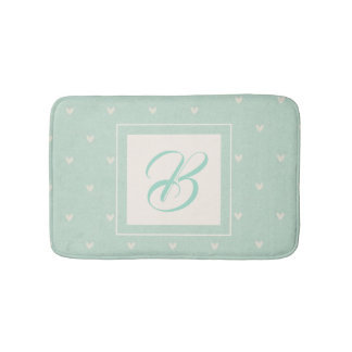 Custom initial with turquoise heart pattern bath mat
