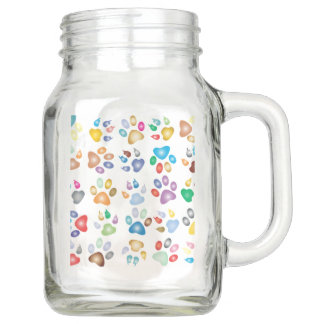 Cute and colorful paw prints on Mason jar with han