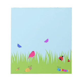 Cute bugs and bird in grass with blue sky notepad
