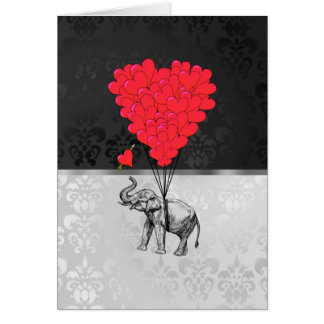 Cute elephant and love heart on grey card