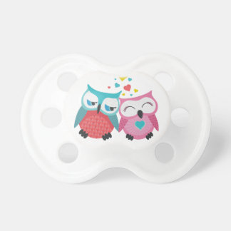 Cute owl couple with hearts pacifier