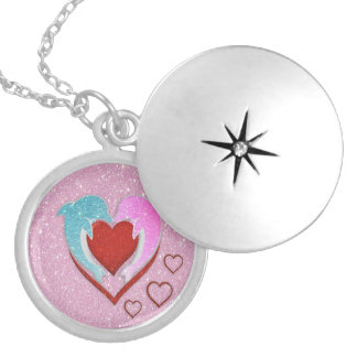 Cute pink blue dolphins holding a red heart locket necklace