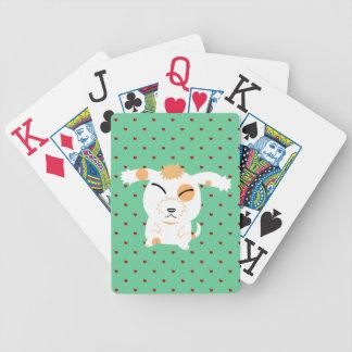 Cute shaggy dog playing cards