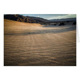 Death valley, desert natural sand dunes near devil card