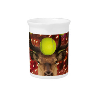 Deer with tennis balls in a shining forest . pitcher