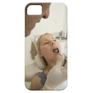 Dentist looking at patients teeth iPhone 5 cover