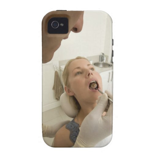 Dentist looking at patients teeth vibe iPhone 4 cases