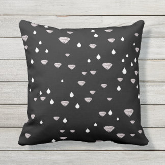diamonds raindrops scattered on black outdoor cushion