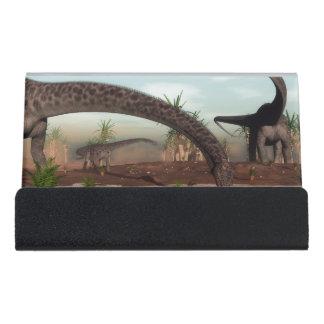 Diplodocus dinosaurs herd going to drink desk business card holder