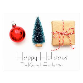 Display of a red Christmas ball ornament Postcard