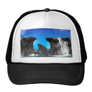 Dolphins swim and jumping in the sea hats