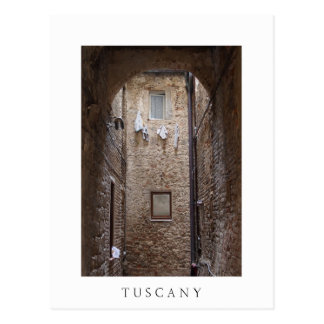 Drying laundry in Tuscany white text postcard