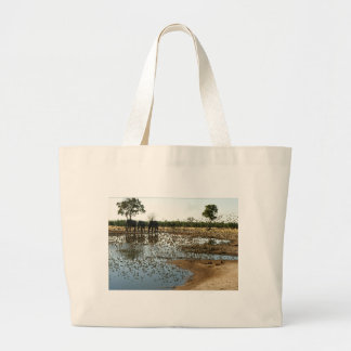 Elephants and Birds at a Waterhole Large Tote Bag