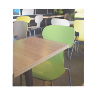 Empty tables and chairs in cafes without visitors notepad