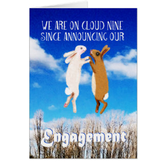 Engagement announcement, two rabbits jumping. greeting card