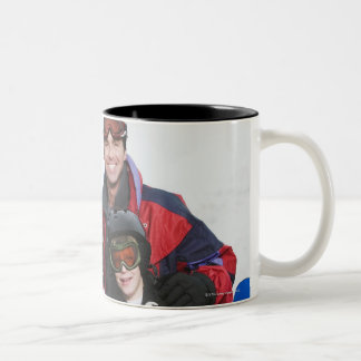 Family portrait with snowboards Two-Tone mug