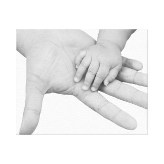 Father holding his baby hand canvas print