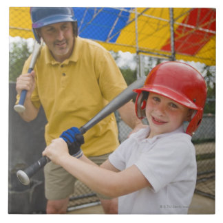 Father with daughter at batting cage large square tile