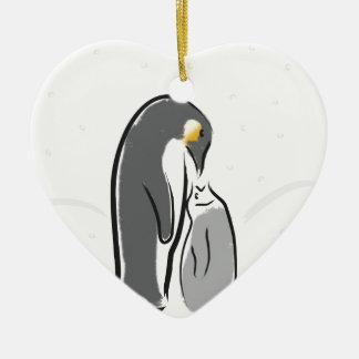 Feeding baby penguin christmas ornament