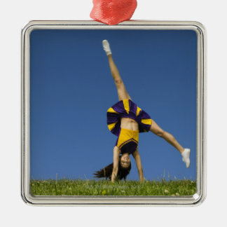 Female cheerleader doing cartwheel christmas ornament