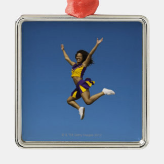 Female cheerleader jumping in air 2 christmas ornament