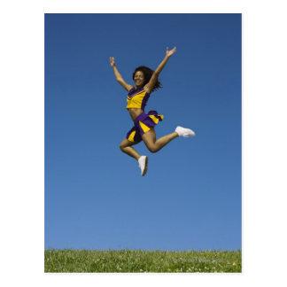 Female cheerleader jumping in air 2 postcard