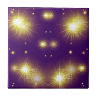 festive golden stars and lights on a small purple tile