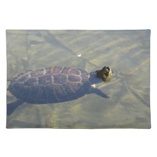 Floating turtle swimming in a pond placemat