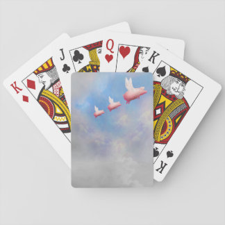 Flying pig mother with her piglets playing cards