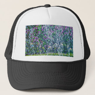 Fointain jets and lilac flowers trucker hat
