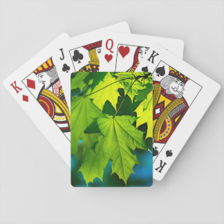 Fresh green maple leaves playing cards
