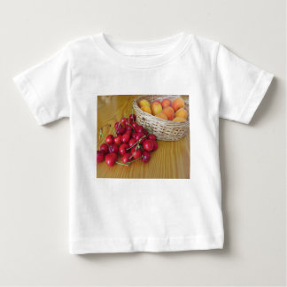 Fresh summer fruits on light wooden table baby T-Shirt
