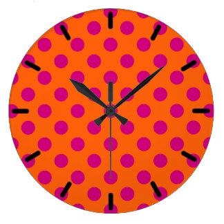 Fuchsia polka dots on orange large clock