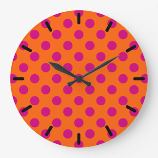 Fuchsia polka dots on orange wallclock