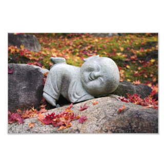 Funny Japanese monk statue with autumn leaves Photograph