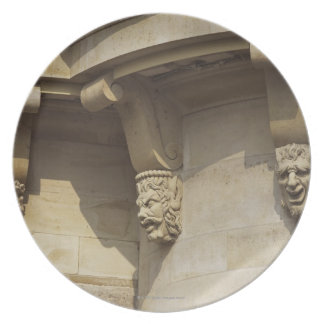 Gargoyles on Pont Neuf bridge in Paris, France Plate