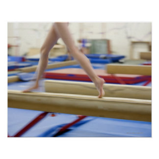 Girl (16-17) running on balance beam, low poster